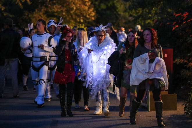 Costumed guests enjoy Zoolala 2018 at the Indianapolis Zoo, Wednesday, Oct. 24, 2018. The annual fundraiser hosted by Indy Zoo Council was Halloween-themed for the first time, inviting guests to wear costumes, enjoy ZooBoo activities and sample beverages from local breweries and cideries.