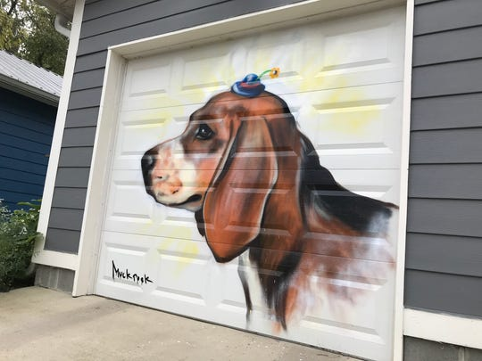 Artist Jules Muck painted this mural of John Sibbitt's beagle on his garage in Fountain Square.
