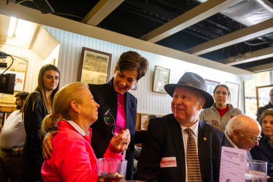 Iowa Gov. Kim Reynolds talks with supporters during a campaign event on Thursday, Oct. 25, 2018, at Hamburg Inn No. 2 in Iowa City.