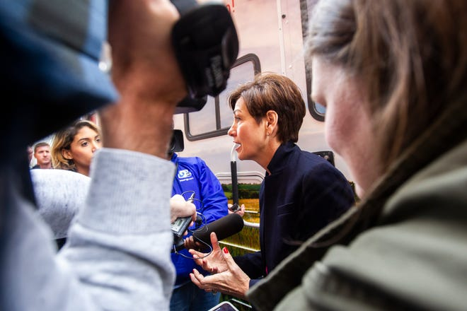 Iowa Gov. Kim Reynolds speaks with reporters after a campaign event on Thursday, Oct. 25, 2018, at Hamburg Inn No. 2 in Iowa City.