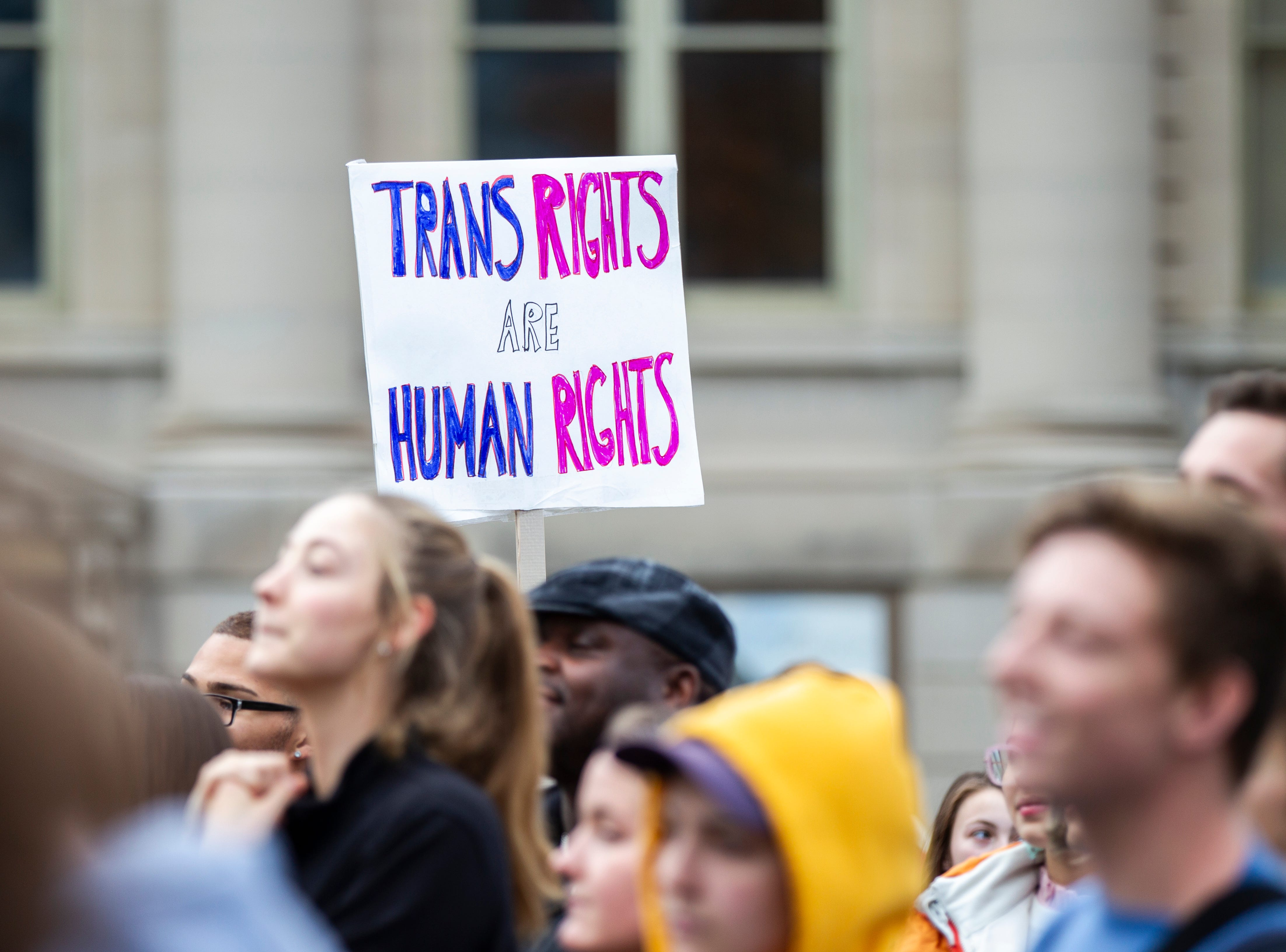 "Community members gather during a ""Support Trans Lives"" rally on Thursday, Oct. 25, 2018, on the east side of the Pentacrest in Iowa City."