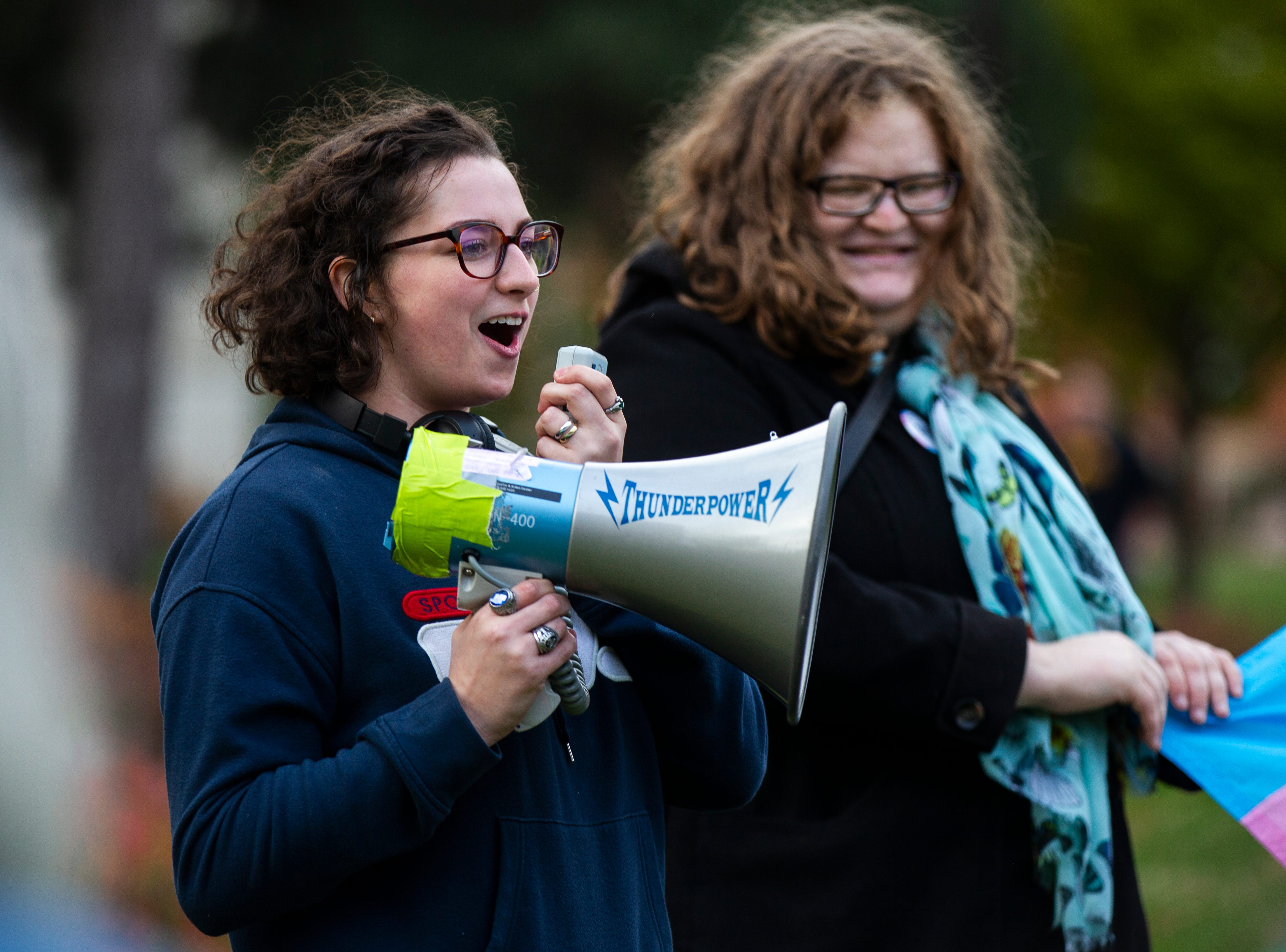 "Margo O' Neill, a University of Iowa senior, speaks during a ""Support Trans Lives"" rally on Thursday, Oct. 25, 2018, on the east side of the Pentacrest in Iowa City."