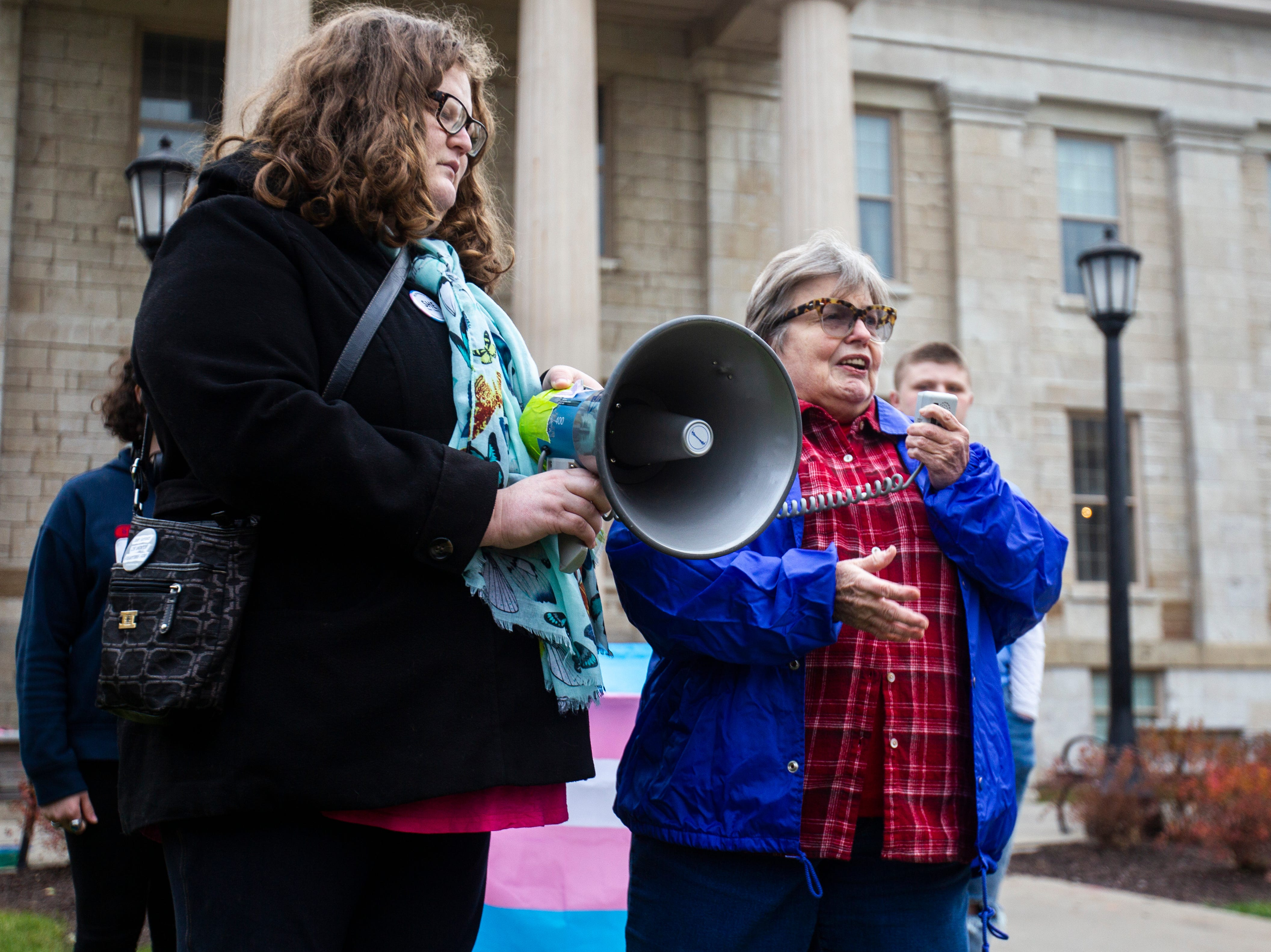 "Liz Voss, of Iowa City speaks during a ""Support Trans Lives"" rally on Thursday, Oct. 25, 2018, on the east side of the Pentacrest in Iowa City."