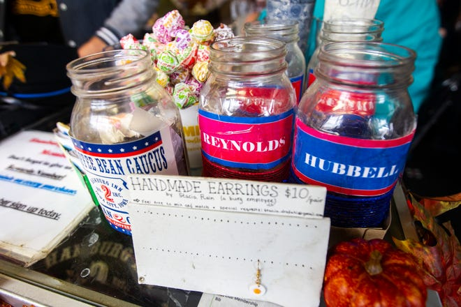"Mason jars sit out next to the cash register for the ""coffee bean caucus"" before a campaign event for Iowa Gov. Kim Reynolds on Thursday, Oct. 25, 2018, at Hamburg Inn No. 2 in Iowa City. Hubbell's jar was leading prior to the Reynolds event."