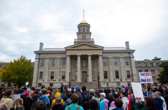 """Community members gather during a """"Support Trans Lives"""" rally on Thursday, Oct. 25, 2018, on the east side of the Pentacrest in Iowa City."""