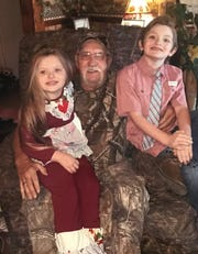 Dakila McCombs said her father Danny McCombs was a devoted grandfather to her two children, Kaliyonna, 6, and Darsun, 8. Kaliyonna especially liked to sit in his camouflage chair with him, Dakila said.