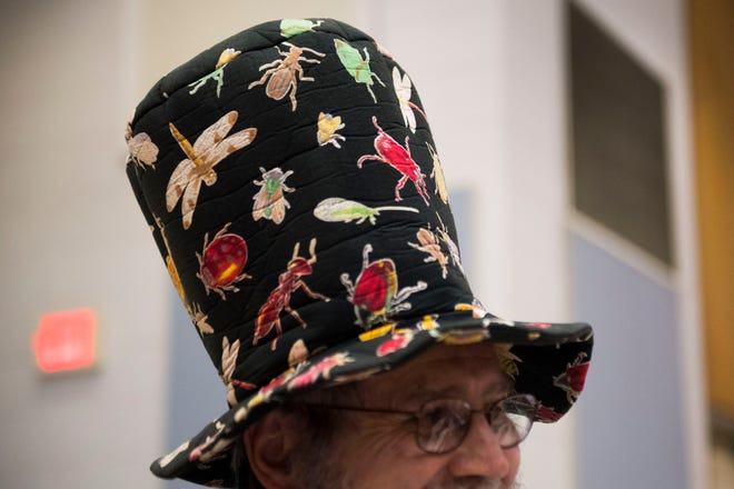 Professor Jerome Grant wears a bug covered hat at University of Tennessee's Institute for Agriculture's Buggy Buffet at UT on Thursday. The buffet is part of Grant's freshman seminar class, and has been going on for 12 years.