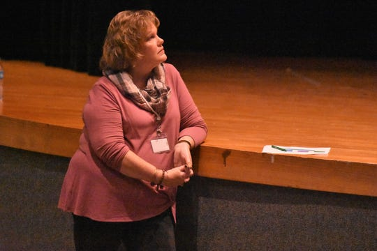 Powell High teacher Susan Martin listens to guest speakers during College/Career Day on Thursday, Oct. 25.