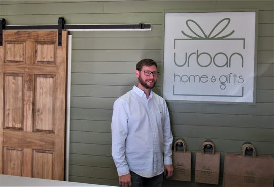 Jesse Boling prepares for the opening of Urban Home & Gifts on Nov. 1. You can shop and go, or order something personalized.