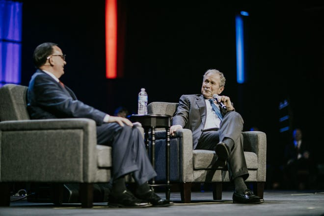 President George W. Bush and Phil Waldrep talk during a question and answer session at the 2018 Celebrators Conference in Pigeon Forge on Wednesday.