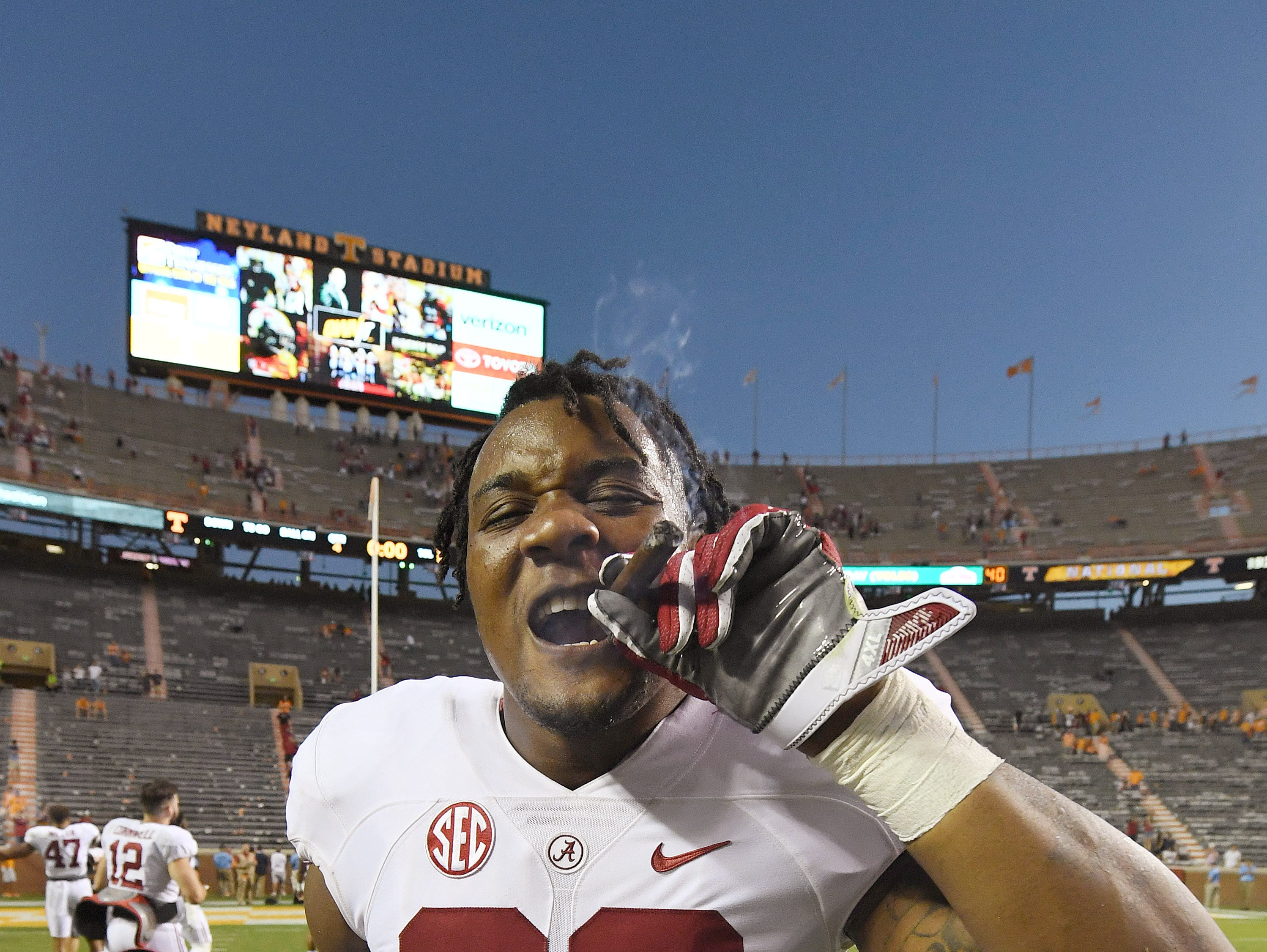 Alabama defensive lineman Raekwon Davis (99) and fellow players celebrate their 49-10 win with a traditional victory cigar after defeating Tennessee at Neyland Stadium on Oct. 15, 2016.
