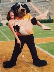 UT majorette Carrie DeLozier Creswell goofs off with the mascot Smokey before a game.