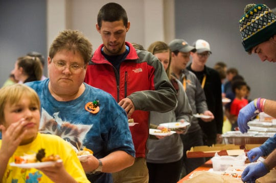Attendees of University of Tennessee's Institute for Agriculture's Buggy Buffet line up for bug-filled foods on Thursday.