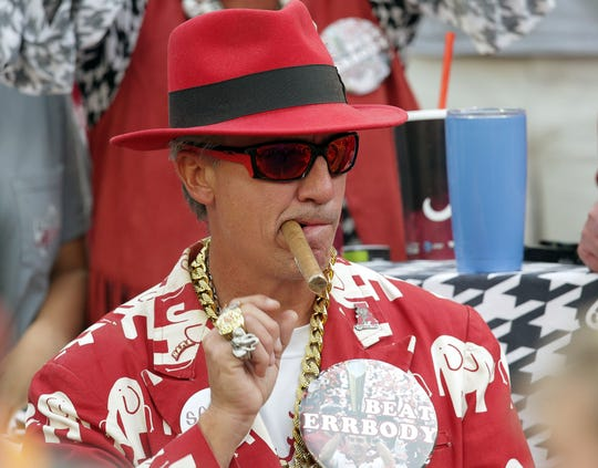 Oct 21, 2017; Tuscaloosa, AL, USA; Alabama Crimson Tide fan with a cigar towards the end of the game against Tennessee Volunteers at Bryant-Denny Stadium. Mandatory Credit: Marvin Gentry-USA TODAY Sports