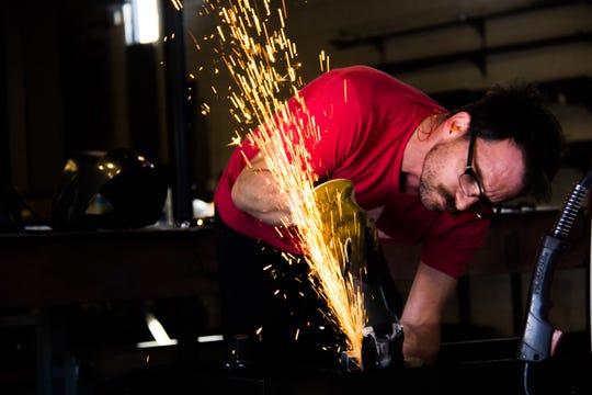 Ryan Engelhardt of Bird on the Wire Studio works to craft a fountain.