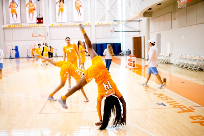 Zaay Green (14) and Rae Burrell (12) do cartwheels during Tennessee Lady Vols Media Day at Pratt Pavilion in Knoxville, Tennessee on Thursday, October 25, 2018.