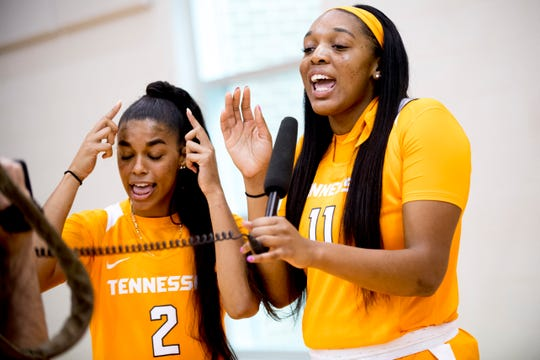 Evina Westbrook (0) and Kasiyahna Kushkituah (11) sing to the camera during Tennessee Lady Vols Media Day at Pratt Pavilion in Knoxville, Tennessee on Thursday, October 25, 2018.