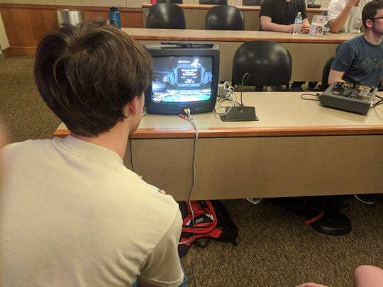 A member of the UTK eSports club plays a video game during a meeting. The club has 200 registered members.