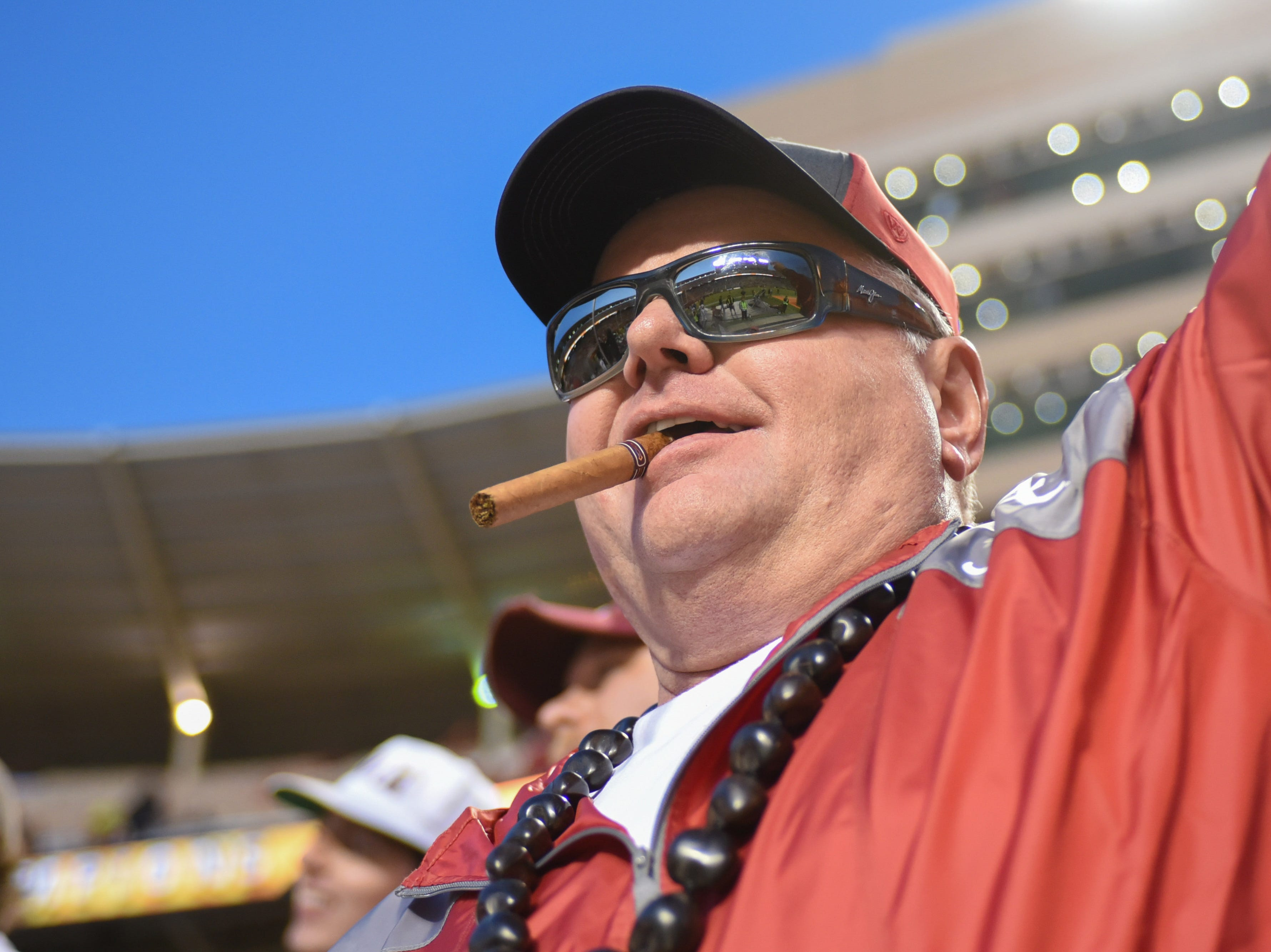 Oct 20, 2018; Knoxville, TN, USA; An Alabama Crimson Tide fan celebrates with a cigar after the game against the Tennessee Volunteers at Neyland Stadium. Alabama won 58 to 21. Mandatory Credit: Randy Sartin-USA TODAY Sports
