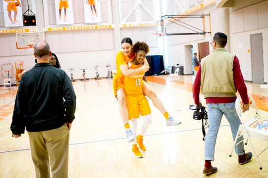 Mimi Collins (4) rides in the shoulders of Jazmine Massengill (13) during Tennessee Lady Vols Media Day at Pratt Pavilion in Knoxville, Tennessee on Thursday, October 25, 2018.