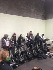 Brighton High School students Cora Mikat, Catie Carruthers, Faith Newton, Leah Tarnacki, Brendan Aten, Ervin Foster, and Owen Cave bike for solar energy during Senior Serve 2018 weekend, Oct. 20-21 at Cass Community Social Services in Detroit.