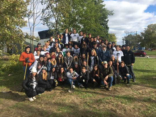 These Brighton High School students spent the weekend of Oct. 20-21 working on behalf of Cass Community Social Services as part of Senior Serve 2018, including cleaning yards for tiny homes in Detroit.