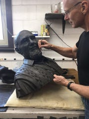 "The bust portion of the Duane Zemper statue, set to be unveiled Nov. 4 in Howell, was combed by Colin Poole, of Santa Fe, New Mexico. He and his wife Kristine were commissioned to create the statue, which is 7 feet tall. ""We use fine stainless steel tools to remove seam lines left on the wax from the mold, repair any defects (like bubbles) and refine details,"" Poole said in the Oct. 6 photo."