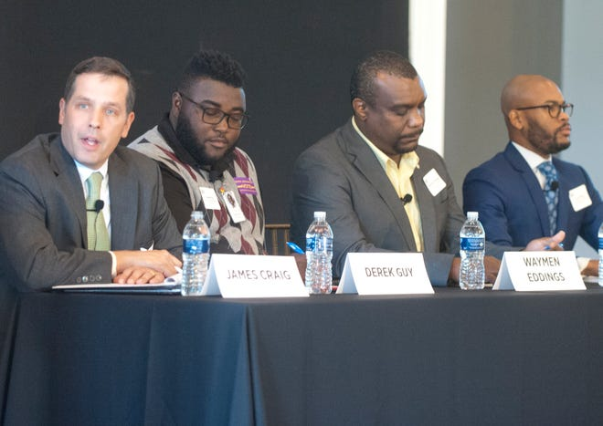 Jefferson County Board of Education candidate James Craig (left) speaks as fellow candidates Derek Guy, Waymen Eddings and Corrie Shull listen as the four participate in a board of education forum sponsored by Greater Louisville, Inc. The event was held at The Olmsted on Frankfort Avenue on Wednesday evening.