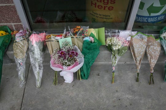 Flowers were left outside a Kroger supermarket in Jeffersontown, Ky., on Thursday, Oct. 25, 2018, to honor the victims of a fatal shooting at the store a day before.