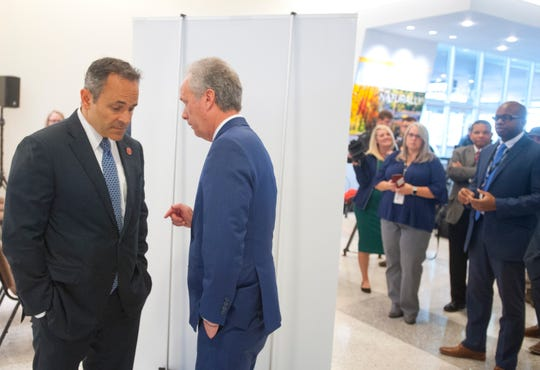 After an announcement at Louisville International Airport, of new direct service to Los Angeles beginning in April, 2019, Kentucky Gov. Matt Bevin, left, and Louisville Mayor Greg Fischer speak behind the announcement poster. Oct. 25, 2018