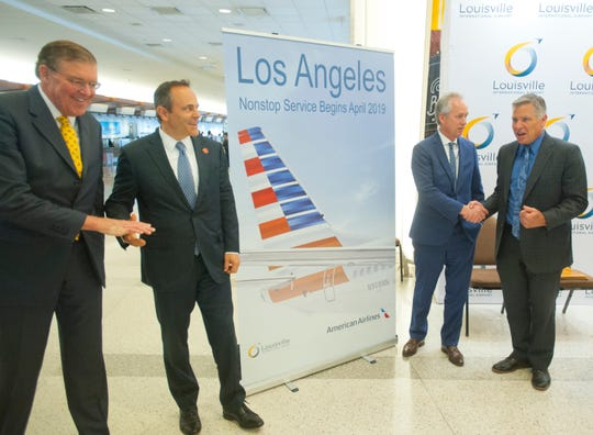 Jim Welch, chairman of the Louisville Regional Airport Authority shakes hands with Kentucky Gov. Matt Bevin, left, and Louisville Mayor Greg Fischer shakes hands with LRAA Executive Director Dan Mann at the announcement of new direct service to Los Angeles beginning in April, 2019. The flights will be provided by American Airlines utilizing a 128-seat Airbus. Oct. 25, 2018