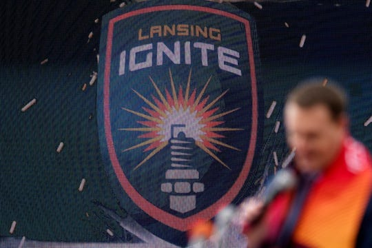 The Lansing Ignite logo is displayed on the scoreboard as Vice President and General Manager Jeremy Sampson, speaks during the announcement of the new professional soccer team on Thursday, Oct. 25, 2018, at Cooley Law School Stadium in Lansing.