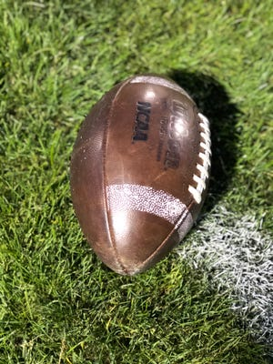 A football sits on the field.