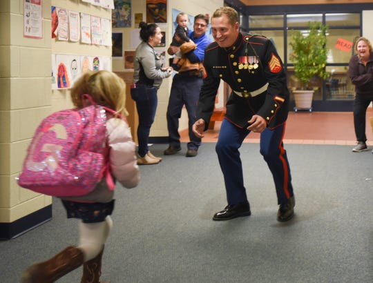 Marine Sgt. Camron Spiece surprises 4-year-old daughter Graycen on Thursday, Oct. 25, 2018, at Oakview South Elementary School in St. Johns. Sgt. Spiece was discharged Wednesday, after spending about a year recovering from a traumatic brain injury caused when a rocket blew up in his face during combat training in North Carolina.