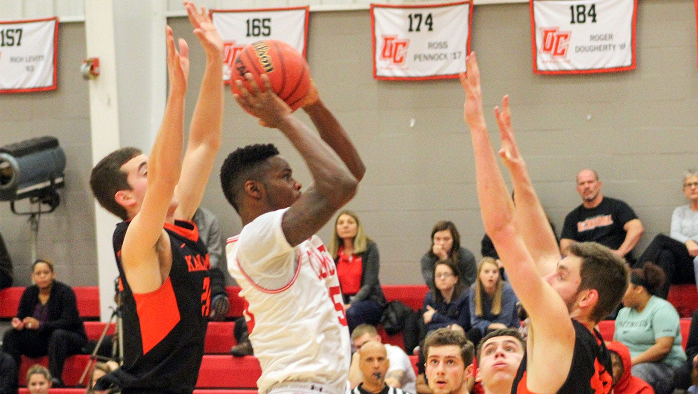 Eldridge Mason (middle) played at Division III Olivet College last season. The guard from Southfield is expected to play for the ABA's Lansing Legends.