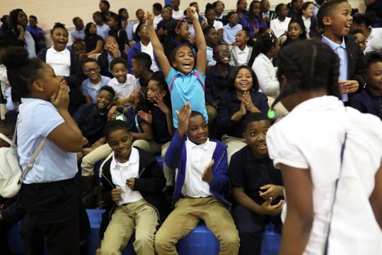 Students cheer on their teacher Erica Stephens as she is announced as the winner of the Milken Educator Award during an assembly Thursday at John P Freeman Optional School.