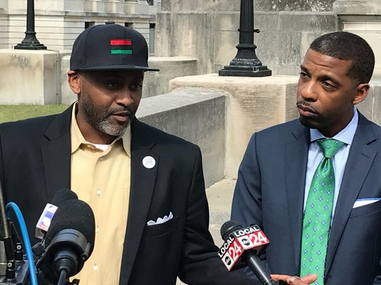 The Rev. Earle Fisher, left, and Alexander Wharton, attorney for the Tennessee Black Voter Project, discuss the lawsuit Wednesday.