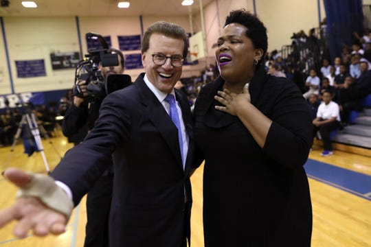 Erica Stephens is announced as the winner of the Milken Educator Award, next to chairman and co-founder of the Milken Family Foundation, Lowell Milken, during an assembly Thursday at John P Freeman Optional School.