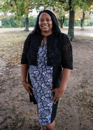 Tina Washington is an instructor at Kirby High School. Washington's grandfather  Elwood Higginbotham, was lynched in Oxford, Mississippi in September of 1935.
