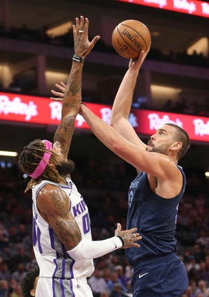 Memphis Grizzlies center Marc Gasol, right, shoots over Sacramento Kings center Willie Cauley-Stein during the first quarter of an NBA basketball game Wednesday, Oct. 24, 2018, in Sacramento, Calif.