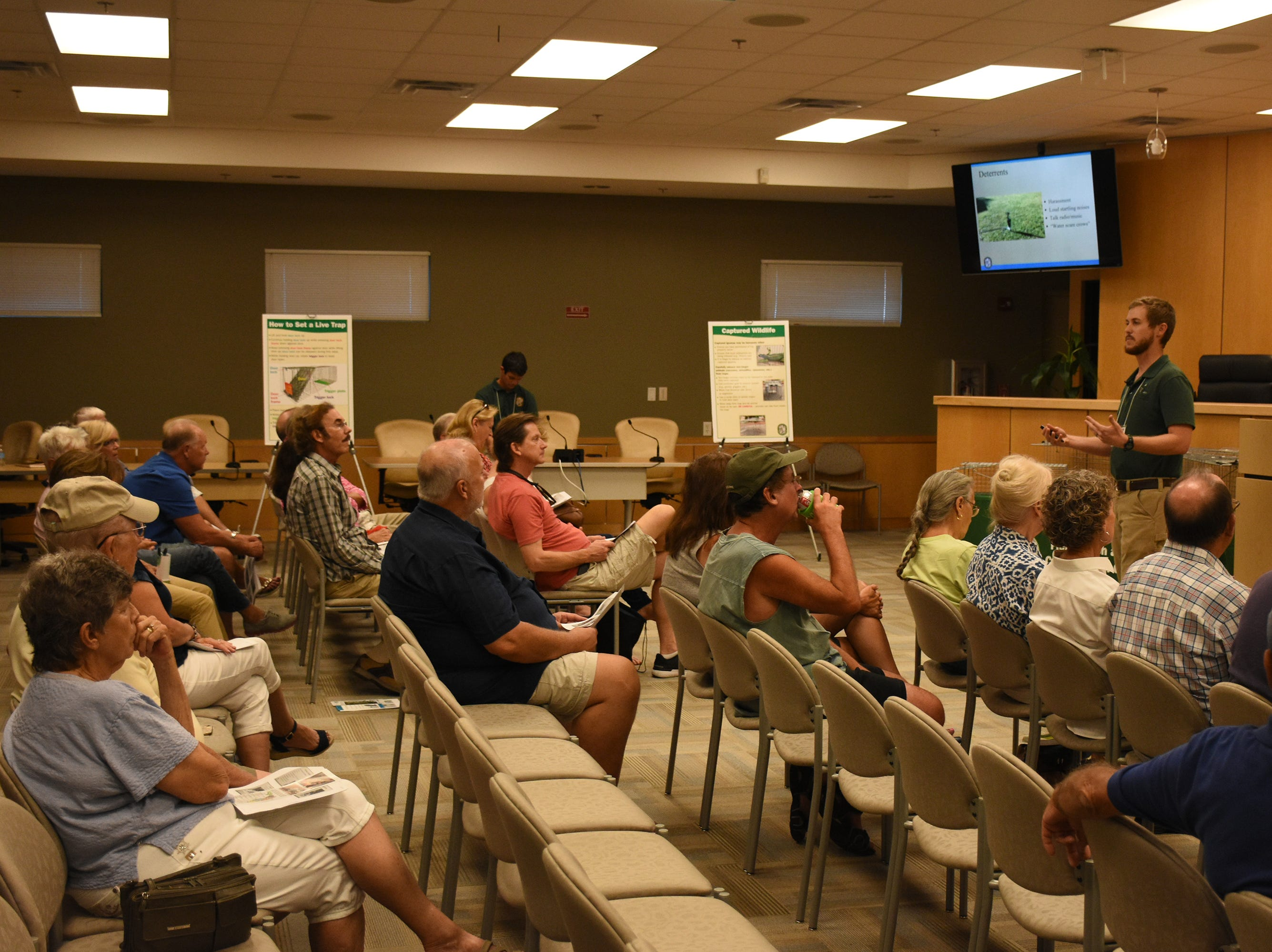 FWC biologist Dan Quinn speaks ro about 40 islanders on dealing with iguanas. The City of Marco Island hosted a presentation on invasive iguanas conducted by the Florida Fish and Wildlife Conservation Commission on Wednesday evening in the Biles Community Room.