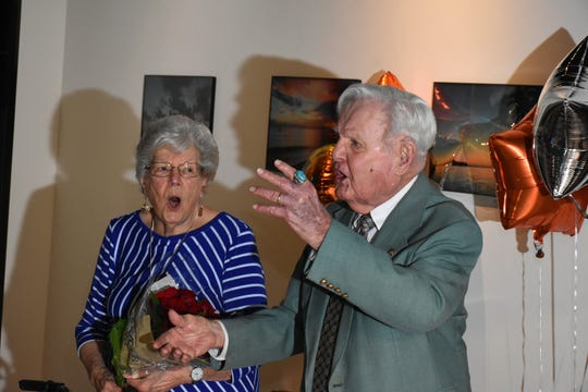 "Emily and Herb Savage lead the assemblage in a rendition of ""God Blesss America."" On Wednesday afternoon, the Marco Island HIstorical Society held an event to celebrate the naming of the Marco Island Historical MuseumÕs Modern Marco Exhibit for island pioneers Herb and Emily Savage."