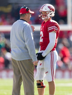 Wisconsin quarterback Alex Hornibrook talks with coach Paul Chryst during a timeout in the the fourth quarter against Illinois last week.