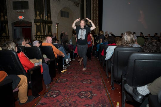 Milwaukee Film's CEO and artistic direct Jonathan Jackson dances in the aisles during a 2014 screening of the film Stop Making Sense.