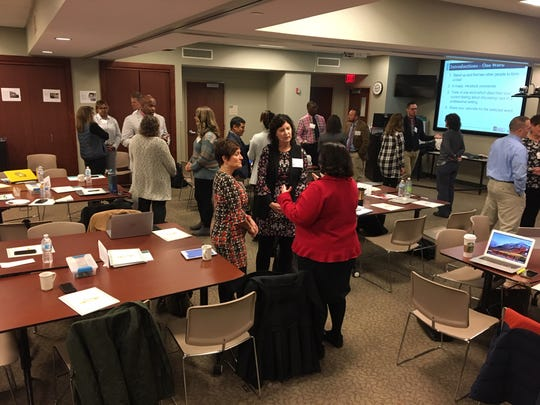 Principals confer in small groups during the first session of the Wisconsin Urban Leadership Institute on Oct. 15. The institute was created as part of a strategy to address black and white achievement and opportunity gaps in the state's five largest school districts.