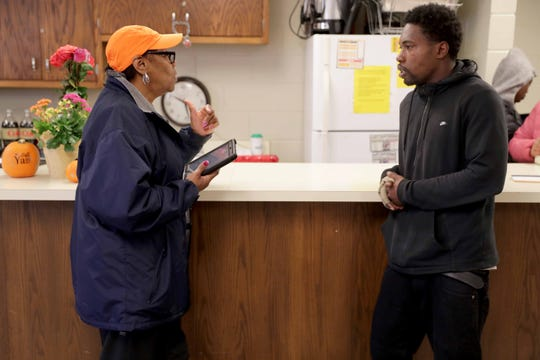 Kiran White (right), a Black Leaders Organizing for Communities ambassador, works with Annie Charleston on role-playing various scenarios they may encounter while knocking on doors to encourage people to vote on Nov. 6. They were meeting at the BLOC headquarters in the AFSCME Milwaukee District Council office on West St. Paul Avenue in Milwaukee.