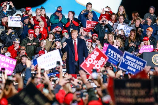 President Donald Trump welcomes fans and supporters during a rally at the Central Wisconsin Airport in Mosinee.
