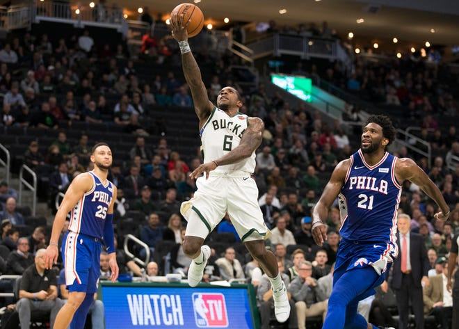 Bucks guard Eric Bledsoe beats Joel Embiid of the 76ers to the basket on a drive and goes up for two of his 18 points on Wednesday night.