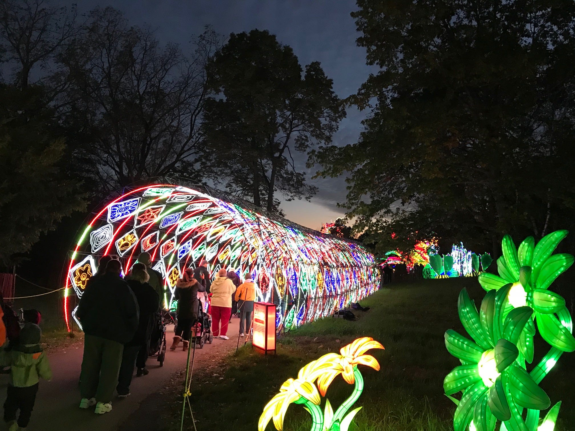 "Guests walk through the lighted ""Time Tunnel,"" which features many displays inside diamond-shaped lights at the 2018 China Lights lantern festival."