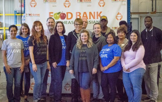 Food Bank Board Members And Staff Pose For A Photo With New Feeding America Ceo Claire Babineaux Fontenot